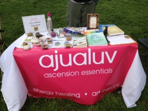The Ajualuv table displayed books on Reiki and energy healing along with grounding tools.