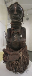 Power Figure (Nkishi) (19th or 20th cen.) from East Kasai province, Democratic Republic of Congo. Made of wood, raffia, metal, cloth, leather, horn, and beads.