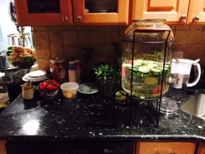 Creating soothing cucumber and lemon water to keep guests hydrated.